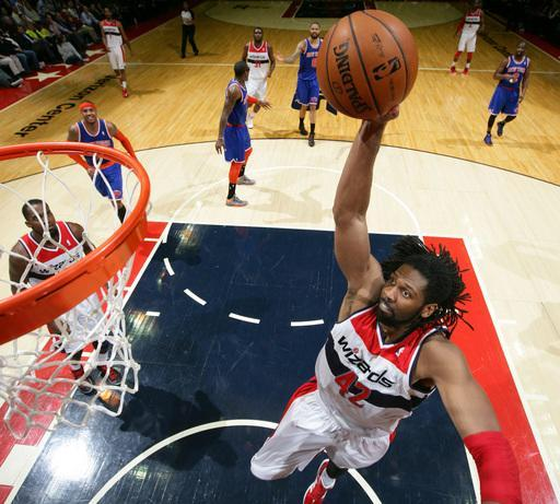 WASHINGTON, DC - FEBRUARY 6: Nene #42 of the Washington Wizards dunks against the New York Knicks during the game at the Verizon Center on February 6, 2013 in Washington, DC. (Photo by Ned Dishman/NBAE via Getty Images)