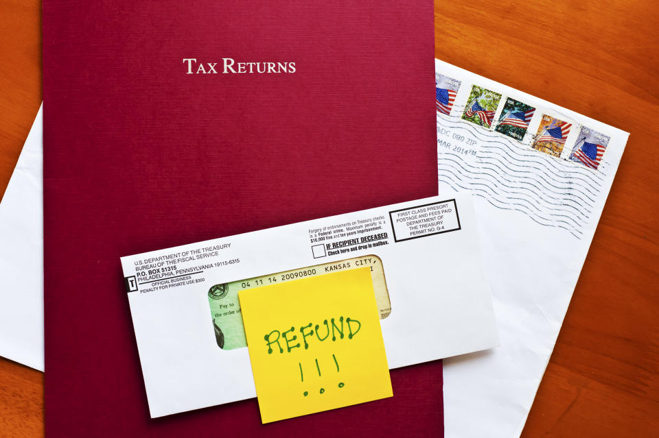 Federal Tax Refund with tax folder and stamped envelope