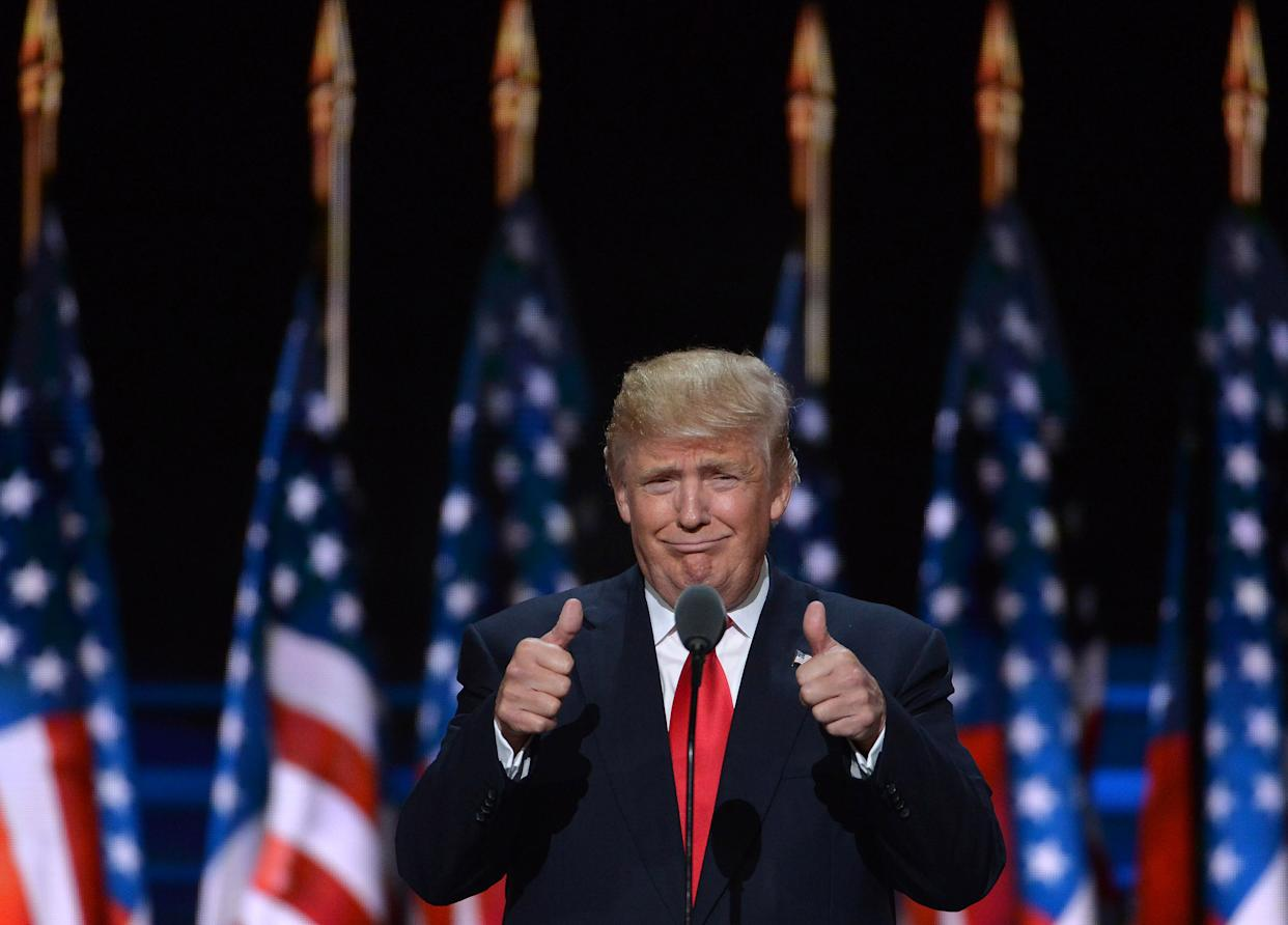 """BEIJING, Nov. 9, 2016 -- File photo taken on July 21, 2016 shows Donald Trump taking the stage on the last day of the Republican National Convention in Cleveland, Ohio, the United States.    Former real estate tycoon Donald Trump has been elected the 45th president of the United States after a neck-and-neck race with his Democratic rival Hillary Clinton.     Born on June 14, 1946, in New York, Trump started his career in his father's real estate firm in 1968 after graduation from Wharton School of the University of Pennsylvania, and was given control of the company in 1971, when he renamed the company """"The Trump Organization.""""     Since then, Trump expanded the business by building casinos, golf courses, hotels and other properties and started marketing his name on a number of building projects and commercial products and services.     He was also famous as a reality television star as the host of his 14-season run """"The Apprentice.""""     Trump announced his presidential candidacy in June 2015, portraying himself as a Washington outsider. The announcement ended his long history of presidential flirtations that started in 1987 and were revived in 2000, 2004, 2008 and 2012 elections.(Xinhua/Yin Bogu via Getty Images)"""