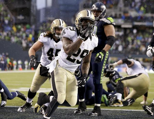 New Orleans Saints running back Khiry Robinson (29) celebrates after running for a 1-yard touchdown during the fourth quarter of an NFC divisional playoff NFL football game against the Seattle Seahawks in Seattle, Saturday, Jan. 11, 2014. (AP Photo/Elaine Thompson)