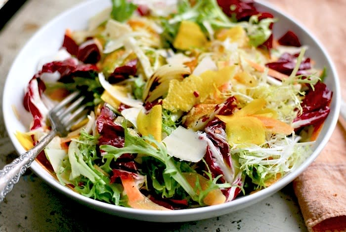 """<div class=""""caption-credit""""> Photo by: Brooklyn Supper</div><b>Colorful Winter Salad</b> <br> A mixed veggie salad can bring a big pop of color to dreary winter tables, and all those colors mean the dish is packed with lots of healthy vitamins. Bitter greens like radicchio and frisee balanced by sweet and smoky cippolini onions, and creamy Asiago cheese, make this salad downright hearty, especially with a couple of over-easy eggs. <br> <a href=""""http://www.babble.com/best-recipes/healthy-holiday-15-eye-catching-salad-recipes/#colorful-winter-salad"""" rel=""""nofollow noopener"""" target=""""_blank"""" data-ylk=""""slk:Get the recipe"""" class=""""link rapid-noclick-resp""""><i>Get the recipe</i></a> <br>"""