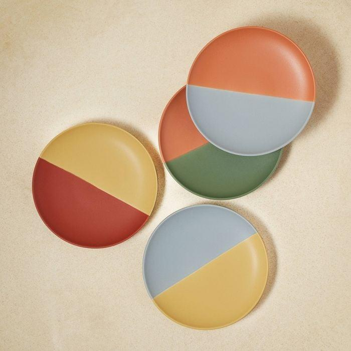<p>Speaking of dinnerware, why settle for one color when you can enjoy a few? Available in a handful of color-blocked palettes, these <span> Stoneware Two-Tone Appetizer Plates</span> ($20) are just as eye-catching as the hor d'oeuvres you'll place on them. </p>