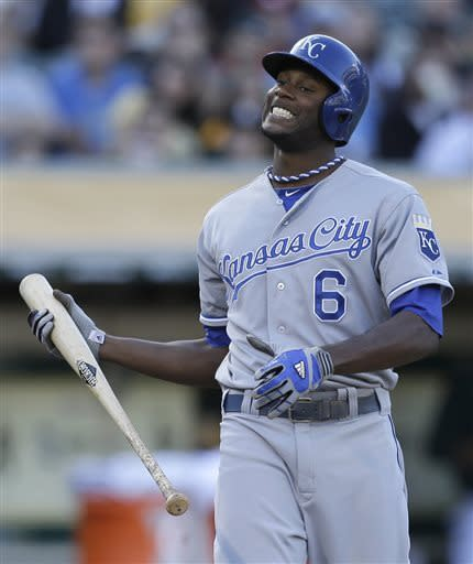 Kansas City Royals' Lorenzo Cain reacts after fouling a pitch thrown by Oakland Athletics' Tommy Milone in the second inning of a baseball game Saturday, May 18, 2013, in Oakland, Calif. (AP Photo/Ben Margot)