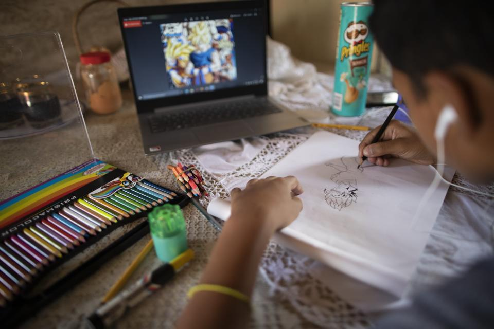 Samuel Andres Mendoza draws at his home, with the intention of selling it online in Barquisimeto, Venezuela, Tuesday, March 2, 2021. In a country where workers earn an average of $2 per month, the teen's drawings can make a big difference for a strained family budget. (AP Photo/Ariana Cubillos)