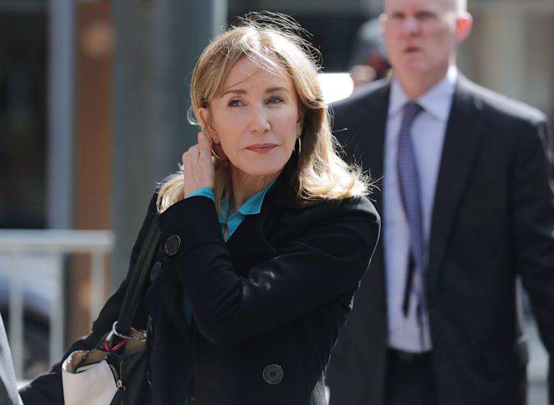 Felicity Huffman arrives at federal court in Boston on April 3, 2019, to face charges in a nationwide college admissions bribery scandal.