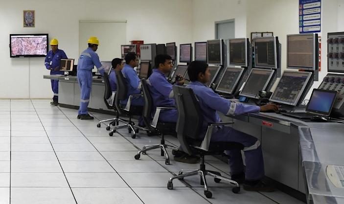 Employees work in the control room of Cairn India, an oil and gas exploration plant, in Barmer, Rajasthan (AFP Photo/Money Sharma)
