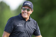 Phil Mickelson smiles after finishing the round on the ninth hole during the first round of the Wells Fargo Championship golf tournament at Quail Hollow Club on Thursday, May 6, 2021, in Charlotte, N.C. (AP Photo/Jacob Kupferman)