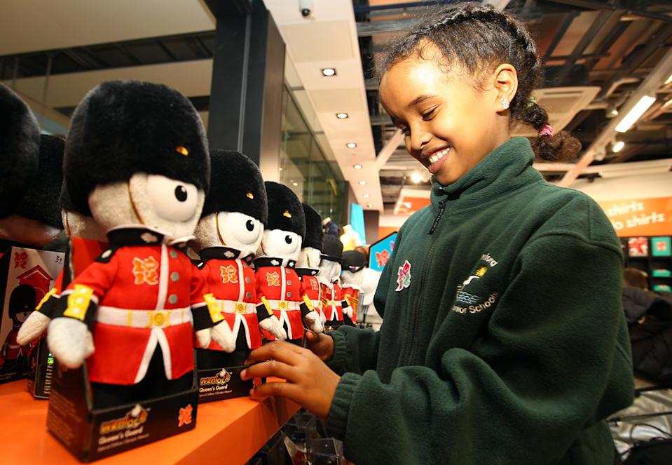 A school girl from Cranford Primary School checks out the merchandise inside the new London 2012 store during the London 2012 Shop Opening At Heathrow Terminal 5 at Heathrow Airport on March 1, 2011 in London, England. (Photo by Julian Finney/Getty Images for LOCOG)