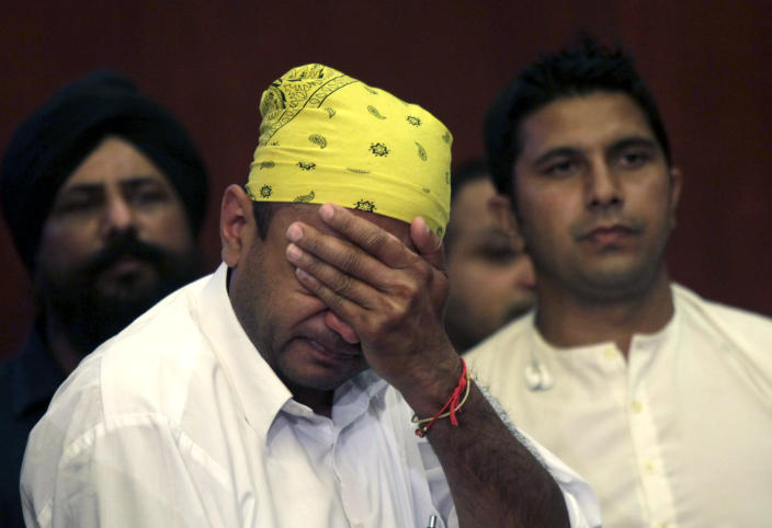 Members of the Sikh community attend a press conference on the shooting at the Sikh Temple of Wisconsin where yesterday a gunman fired upon people at service August, 6, 2012 in Oak Creek, Wisconsin. At least six people were killed when the shooter identified as Wade Michael Page opened fire on congregants in the Milwaukee suburb. The suspect who was a United States Army veteran was shot dead in a shootout with police. (Photo by Darren Hauck/Getty Images)