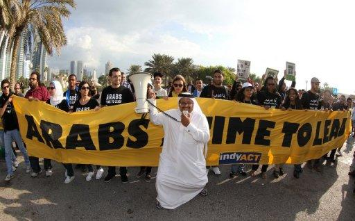 Activists in Doha on December 1, 2012 outside the United Nations Convention on Climate Change