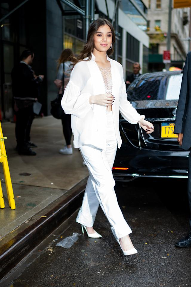 <p>Wearing white separates with matching heels while out in New York. </p>