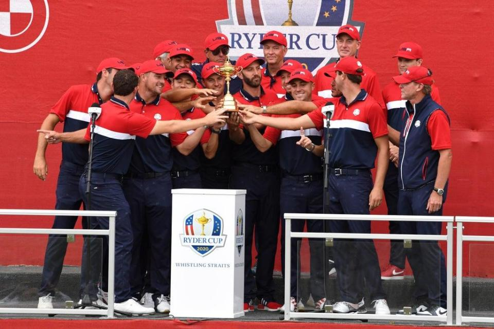 Team USA celebrate with the Ryder Cup trophy after their crushing victory over Europe at Whistling Straits (Anthony Behar/PA) (PA Wire)
