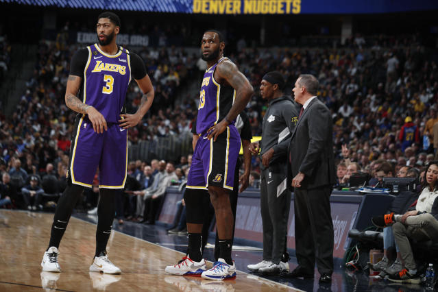 Los Angeles Lakers forward Anthony Davis (3) and Los Angeles Lakers forward LeBron James (23) in the second half overtime of an NBA basketball game Wednesday, Feb. 12, 2020, in Denver. The Lakers won 120-116 in overtime. (AP Photo/David Zalubowski)