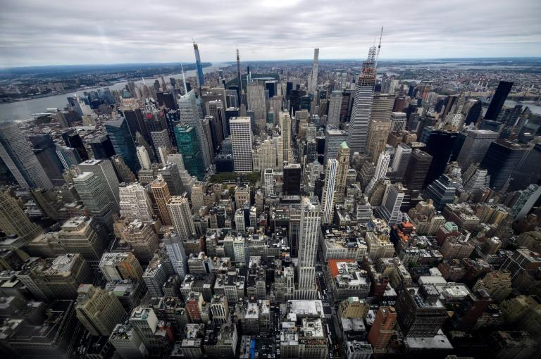 View toward midtown Manhattan inside the newly renovated 102nd floor observatory of the Empire State Building on October 11, 2019 in New York City. Opening to the public on October 12, the new 102nd floor observatory is 1250 feet above street level and features 360 degree views of New York City. (AFP Photo/Johannes EISELE)