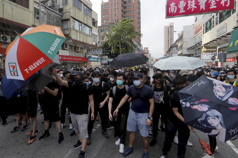 Protesters march in Hong Kong Saturday, July 13, 2019. Several thousand people marched in Hong Kong on Saturday against traders from mainland China in what is fast becoming a summer of unrest in the semi-autonomous Chinese territory. (AP Photo/Kin Cheung)