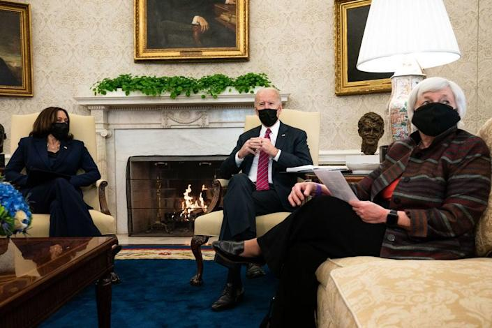 President Joe Biden, middle, meets with Vice President Kamala Harris, left, and Treasury Secretary Janet Yellen about how to move forward amid the coronavirus pandemic. (Getty Images)