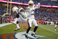 Los Angeles Chargers running back Austin Ekeler, left, celebrates after scoring with wide receiver Andre Patton during the first half of an NFL football game against the Denver Broncos Sunday, Dec. 1, 2019, in Denver. (AP Photo/David Zalubowski)