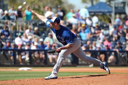 Mar 7, 2019; Port Charlotte, FL, USA; Toronto Blue Jays pitcher John Axford (77) throws a pitch during the fourth inning against the Tampa Bay Rays at Charlotte Sports Park. Mandatory Credit: Kim Klement-USA TODAY Sports