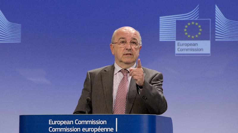 European Commissioner for Competition Joaquin Almunia gestures while speaking during a media conference at EU headquarters in Brussels, Monday, Jan. 13, 2014. The European Union's antitrust watchdog says it has opened an investigation on licensing agreements between several major U.S. film studios and European pay TV broadcasters. Its probe covers Twentieth Century Fox, Warner Bros., Sony Pictures, NBCUniversal and Paramount Pictures. (AP Photo/Virginia Mayo)