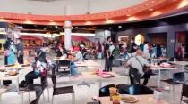 People stand during a tremor, at a food court in Royal Plaza in Surabaya
