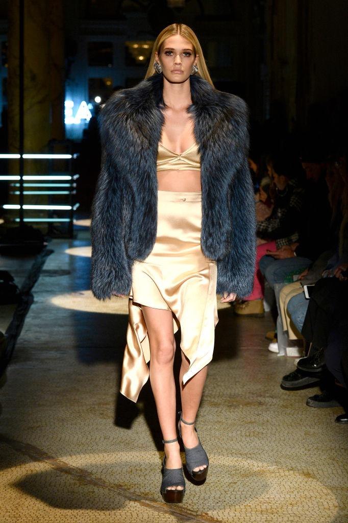 It is often difficult to tell whether the fur worn on the catwalk is real or fake [Photo: Getty]