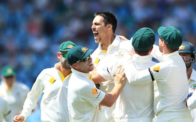 Australia's bowler Mitchell Johnson, center, celebrates with teammates after dismissing South Africa's captain Graeme Smith, for 10 runs on the second day of their their cricket test match at Centurion Park in Pretoria, South Africa, Thursday, Feb. 13, 2014. (AP Photo/ Themba Hadebe)