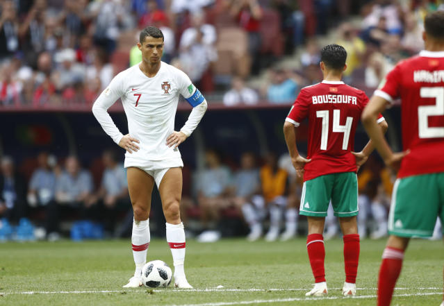 Portugal's Cristiano Ronaldo, left, prepares to shot a free kick during the group B match between Portugal and Morocco at the 2018 soccer World Cup in the Luzhniki Stadium in Moscow, Russia, Wednesday, June 20, 2018. (AP Photo/Matthias Schrader)