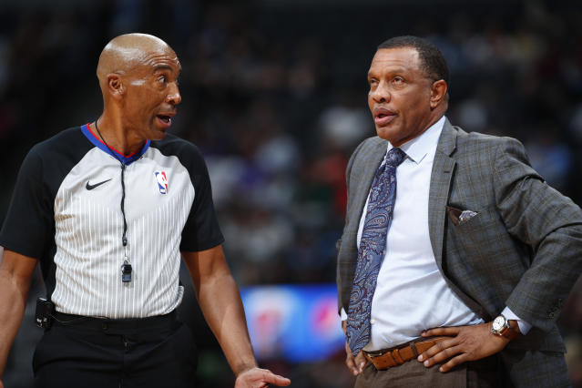 Referee Leon Wood, left, explains a foul call to New Orleans Pelicans head coach Alvin Gentry in the first half of an NBA basketball game against the Denver Nuggets, Friday, Dec. 15, 2017, in Denver. (AP Photo/David Zalubowski)