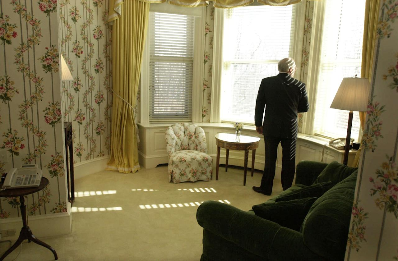 Vice President Dick Cheney looks out a window in the private quarters of the Vice President's residence before hosting a reception at the home, Sunday, Jan. 21, 2001, in Washington. (AP Photo/M. Spencer Green)