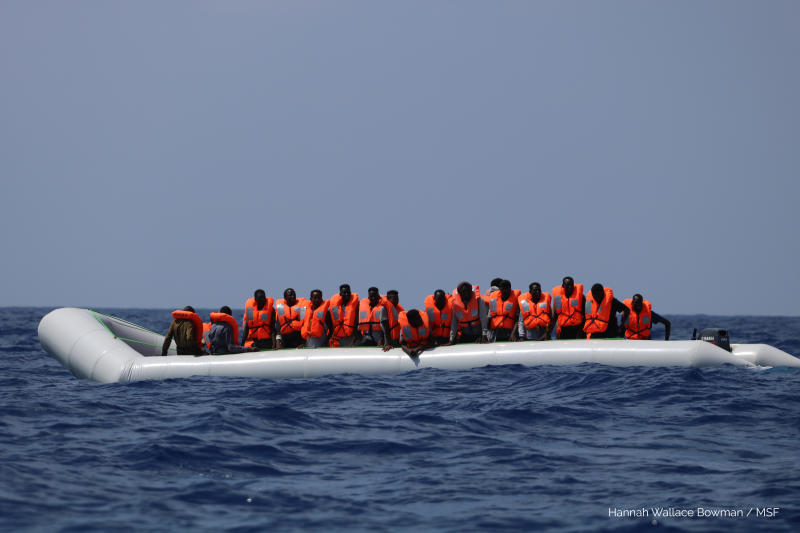 In this photo taken Saturday and released Sunday, Aug. 11, 2019, a rubber dinghy with over 80 migrants off the Libyan coast has received life vests from a rescue team of the Ocean Viking ship, operated by the NGOs Sos Mediterranee and Doctors Without Borders. The Ocean Viking was already carrying over 80 people rescued earlier, and is blocked at sea while it waits to be assigned a safe port. Italian Interior Minister Matteo Salvini, who has triggered a government crisis in Italy, signed Friday a ban on the ship's entry into Italian waters. (Hannah Wallace Bowman/MSF/Sos Mediterranee via AP)