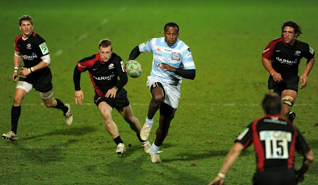Racing's Wing Sereli Bobo (C) breaks through the Saracen's defence on his way to score a try during the Heineken Cup rugby union match between Saracens and Racing Metro 92 at Vicarage Road in Watford on December 11, 2010. Racing Metro 92 won the game 24-21. AFP PHOTO / Adrian Dennis (Photo credit should read ADRIAN DENNIS/AFP/Getty Images)