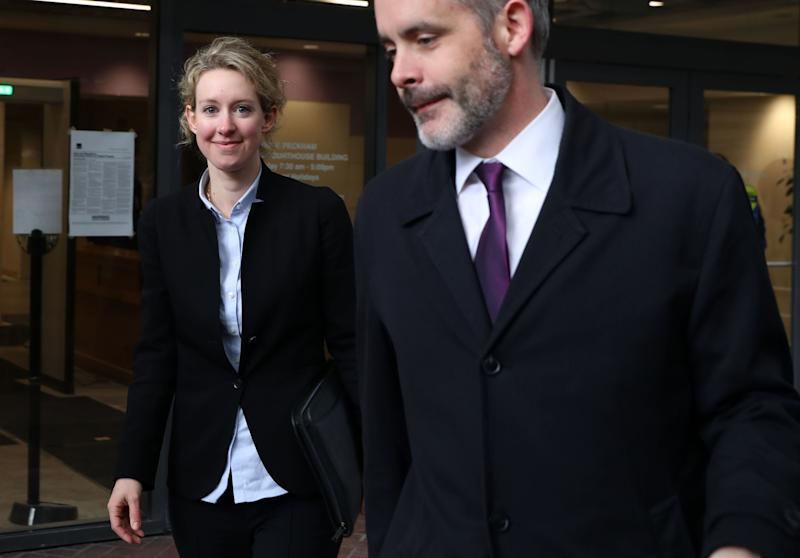 SAN JOSE, CALIFORNIA - JANUARY 14: Former Theranos founder and CEO Elizabeth Holmes (L) leaves the Robert F. Peckham U.S. Federal Court on January 14, 2019 in San Jose, California. Former Theranos CEO Elizabeth Holmes and former COO Ramesh Balwani appeared in federal court facing charges of conspiracy and wire fraud for allegedly engaging in a multimillion-dollar scheme to defraud investors with the Theranos blood testing lab services. (Photo by Justin Sullivan/Getty Images)