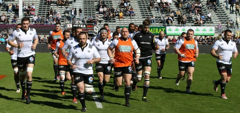 Brive's players warm up before a French Top 14 rugby union match against Montpellier on March 26, 2017