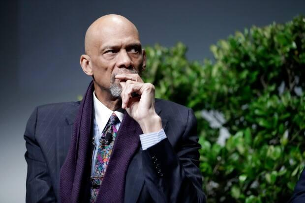Former NBA player Kareem Abdul-Jabbar, seen above in 2017, is speaking out against NBA players who are still unwilling to get vaccinated against COVID-19. (Marcio Jose Sanchez/The Associated Press - image credit)