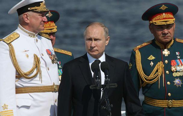 PHOTO: Russian President Vladimir Putin, Defence Minister Sergei Shoigu (R) and Chief Commander of Russian Navy Nikolai Yevmenov watch the Navy Day Parade on July 28, 2019 in Saint Petersburg, Russia. (Mikhail Svetlov/Getty Images)