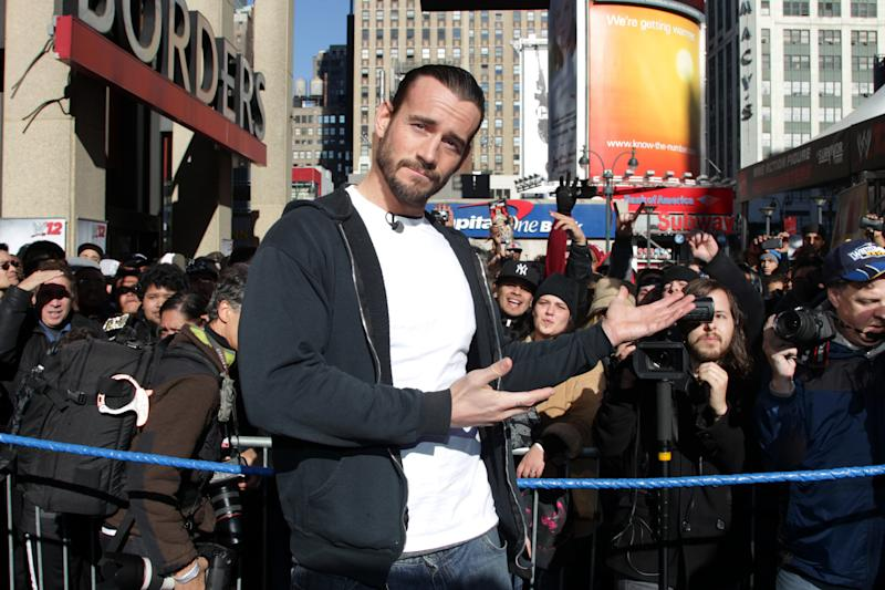 """WWE Superstar CM Punk poses at Madison Square Garden, Friday, Nov. 18, 2011, in New York, during a rally leading up to the 25th Anniversary of Survivor Series, taking place Sunday at Madison Square Garden. The event will feature actor and wrestling favorite Dwayne """"The Rock"""" Johnson who will compete in his first match in nearly seven years. The event will be broadcast live on pay-per-view. (AP Photo/Starpix, Dave Allocca) -PICTURED: CM Punk -PHOTO by: Dave Allocca/StarPix -Filename: Da27825087.JPG -Location: Madison Square Garden"""