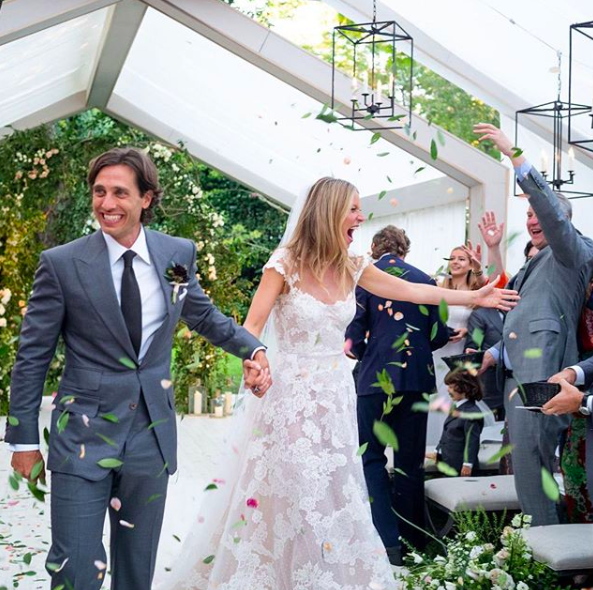 <p>Gwyneth Paltrow and television producer Brad Falchuck tied the knot in a private ceremony shortly after her 46th birthday. For the star-studded event, the Goop founder wore a lace couture gown by Valentino before changing into a playsuit by close friend Stella McCartney for the after-party. <em>[Photo: Instagram]</em> </p>