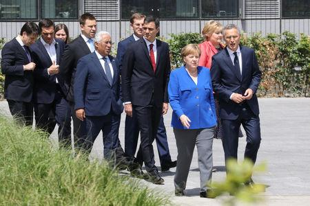 German Chancellor Angela Merkel, NATO Secretary General Jens Stoltenberg, Norway's Prime Minister Erna Solberg, Spain's Prime Minister Pedro Sanchez, Portugal's Prime Minister Antonio Costa, Greek Prime Minister Alexis Tsipras and Italy's Prime Minister Giuseppe Conte arrive for a family picture ahead of the opening ceremony of the NATO (North Atlantic Treaty Organization) summit, at the NATO headquarters in Brussels, Belgium, July 11, 2018.  Ludovic Marin/Pool via REUTERS