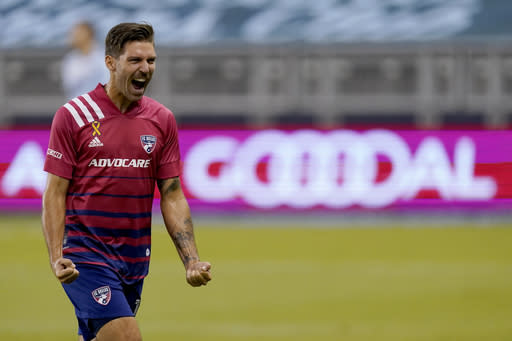 FC Dallas midfielder Ryan Hollingshead celebrates a goal by Franco Jara during the first half of an MLS soccer match against Sporting Kansas City Wednesday, Sept. 2, 2020, in Kansas City, Kan. (AP Photo/Charlie Riedel)