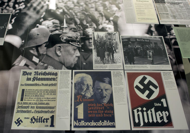 A poster, front center, showing Adolf Hitler, right, and Reich Chancellor Paul von Hindenburg, left, is pictured at the 'Berlin 1933 - the way to despotism' exhibition at the Topography of Terror museum in Berlin, Germany, Wednesday, Jan. 30, 2013. The Topography of Terror museum is located at the area where the headquarters of the Gestapo and SS were destroyed by allied bombing. (AP Photo/Michael Sohn)