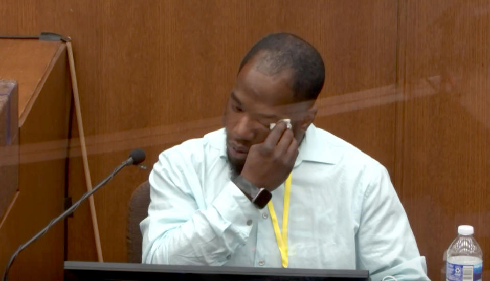 Donald Williams wipes away tears as he testifies in the Derek Chauvin trial in Minneapolis on Tuesday. (Via Reuters Video)