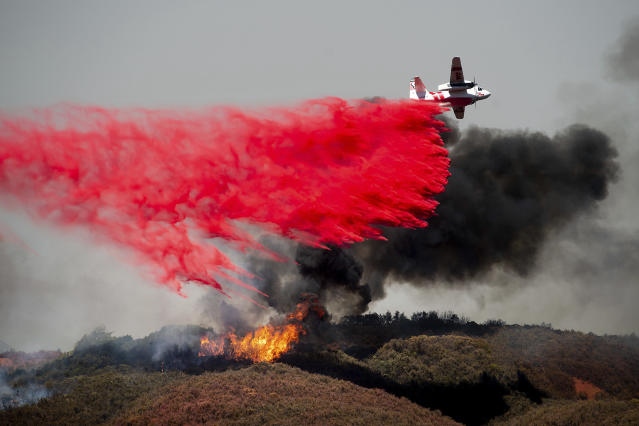 <p>An air tanker drops retardant on a wildfire burning near Lakeport, Calif., on Monday, July 30, 2018. (Photo: Noah Berger/AP) </p>
