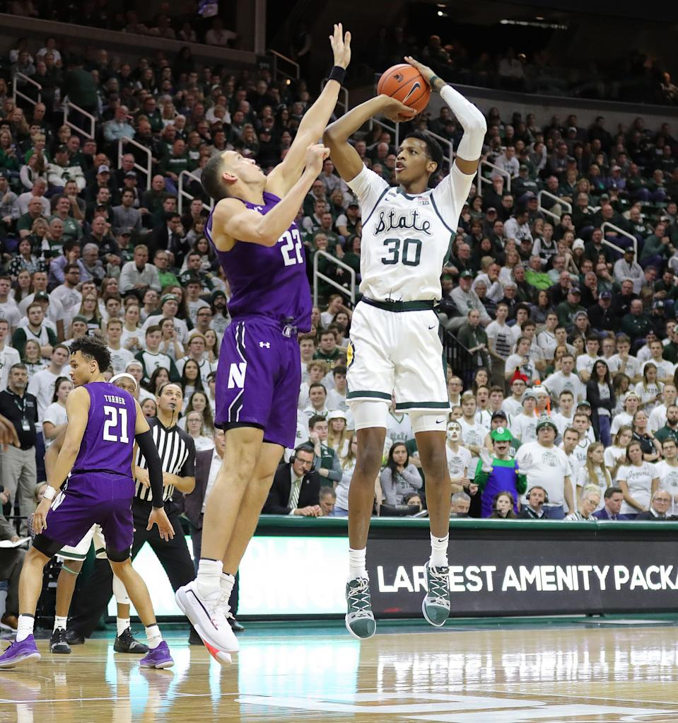 Michigan State forward Marcus Bingham Jr. scores against Northwestern forward Pete Nance during second half of MSU's 79-50 win on Wednesday, Jan. 29, 2020, at the Breslin Center.