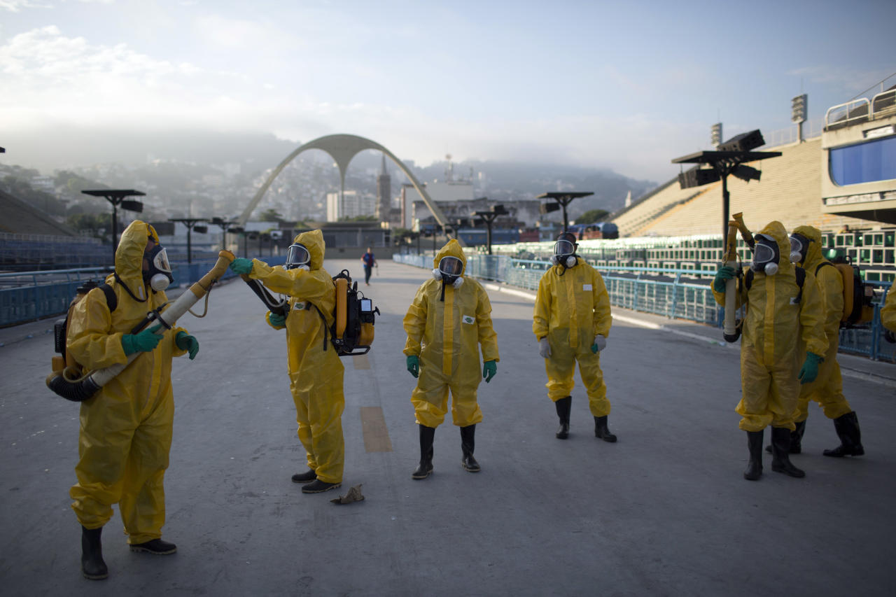 "<p> FILE - In this Tuesday, Jan. 26, 2016 file photo, health workers get ready to spray insecticide to combat the Aedes aegypti mosquitoes that transmits the Zika virus, under the bleachers of the Sambadrome in Rio de Janeiro, which will be used for the Archery competition in the 2016 summer games. More than 145 public health experts signed an open letter to the World Health Organization on Friday, May 27, 2016 asking the U.N. health agency to consider whether the Rio de Janeiro Olympics should be postponed or moved because of the ongoing Zika outbreak. The letter calls for the games to be delayed or relocated ""in the name of public health."" (AP Photo/Leo Correa, File) </p>"