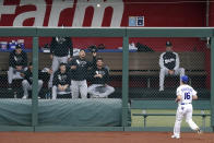 Kansas City Royals left fielder Andrew Benintendi watches as a two-run home run hit by Chicago White Sox's Danny Mendick falls into the White Sox bullpen during the first inning of a baseball game Saturday, May 8, 2021, in Kansas City, Mo. (AP Photo/Charlie Riedel)