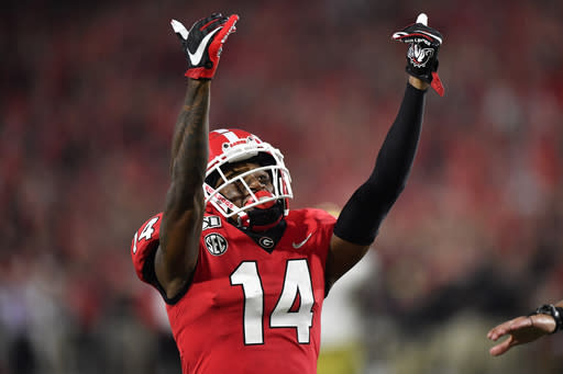 Georgia defensive back DJ Daniel (14) celebrates victory over Notre Dame during the second half of an NCAA college football game, Saturday, Sept. 21, 2019, in Athens, Ga. Georgia won 23-17. (AP Photo/Mike Stewart)