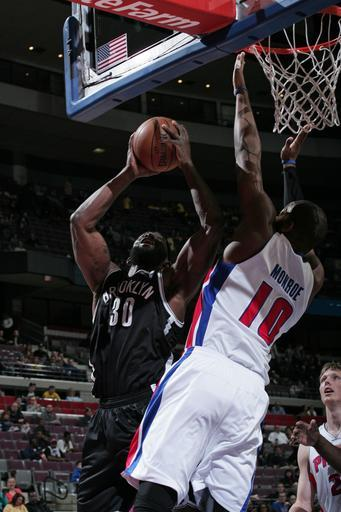 AUBURN HILLS, MI - MARCH 18: Reggie Evans #30 of the Brooklyn Nets shoots against Greg Monroe #10 of the Detroit Pistons on March 18, 2013 at The Palace of Auburn Hills in Auburn Hills, Michigan. (Photo by B. Sevald/Einstein/NBAE via Getty Images)