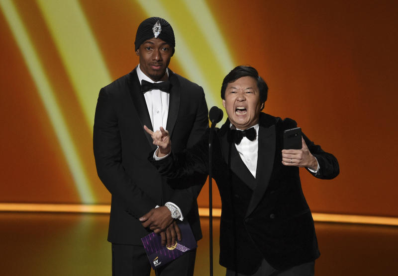 Nick Cannon, left, and Ken Jeong present the award for outstanding writing for a comedy series at the 71st Primetime Emmy Awards on Sunday, Sept. 22, 2019, at the Microsoft Theater in Los Angeles. (Photo by Chris Pizzello/Invision/AP)