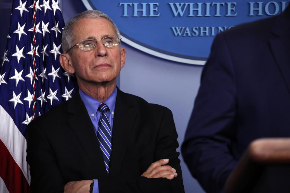 Dr. Anthony Fauci, director of the National Institute of Allergy and Infectious Diseases, listens as President Donald Trump speaks about the coronavirus in the James Brady Briefing Room, Tuesday, March 24, 2020, in Washington. (AP Photo/Alex Brandon)