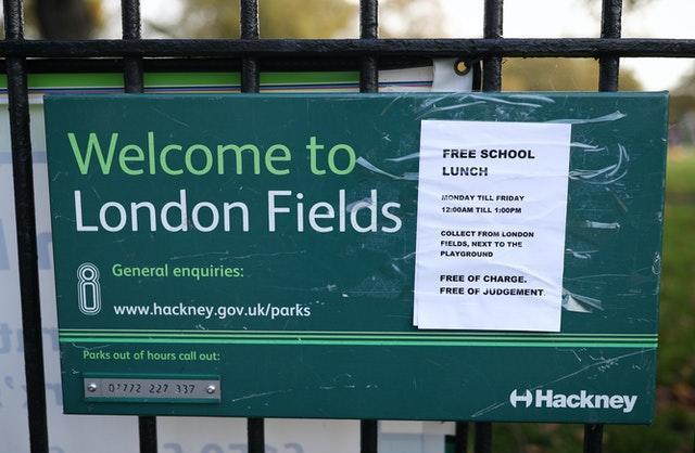 A free lunches sign outside London Fields Primary School in London